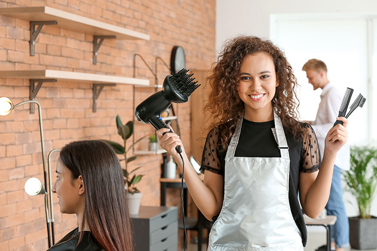 hairdresser with beauty accessories