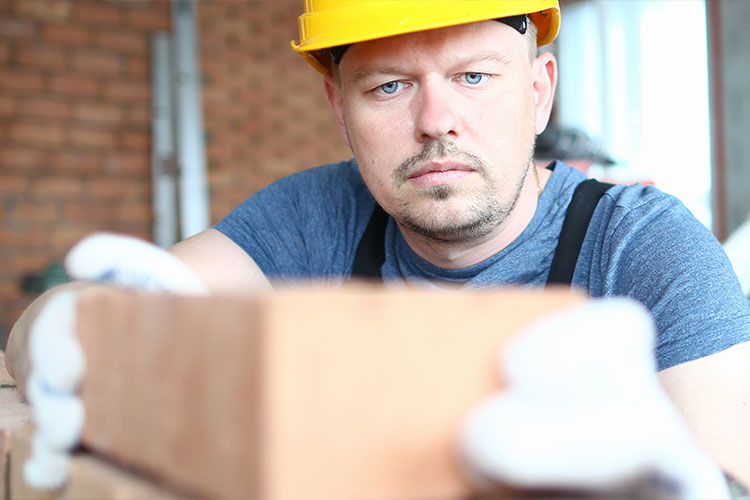 construction worker bricks tax